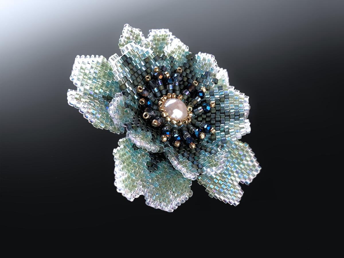 ブルーグリーンのキラキラビーズお花リング